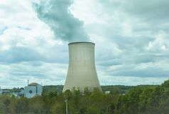 Nuclear Power Station. With smoke in the sky Royalty Free Stock Photo