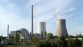 Nuclear power station Philippsburg. The nuclear power station of Philippsburg, Germany, as seen from the south-east. Classic shot keeping reactor and cooling stock footage