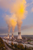 Nuclear Power Station At Sunset. A large nuclear power station by a river during sunset Royalty Free Stock Photo