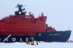 Nuclear-powered icebreaker took expedition to North pole. North pole - 2 July 2016: Nuclear-powered icebreaker took expedition of travelers to North pole Royalty Free Stock Photography