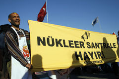 Nuclear protest. Unidentified activist holds banners at a demonstration against nuclear power on November 8,2007,in Istanbul,Turkey Royalty Free Stock Photo