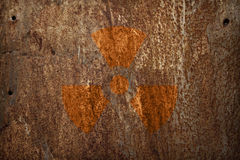 Nuclear radiation sign on metal texture. Nuclear radiation sign on rusty metal texture Stock Photography