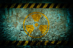 Nuclear radiation warning symbol on grunge wall background Royalty Free Stock Image