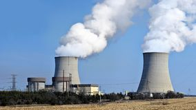 Nuclear reactor containment buildings with cooling tower in background. Nuclear reactor containment buildings and cooling towers royalty free stock photos