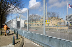 Nuclear Security Summit 2014. The Hague, Holland - March 23, 2014: Large protective fence blocks the entrance to President Kennedy street, where the Nuclear Stock Photography