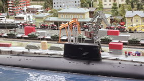 Nuclear submarine in dock. ST. PETERSBURG - JULY 2016: Nuclear submarine in dock in small city, Russia. The Grand Maket, which opened in 2011, is a 1:87 scale stock video