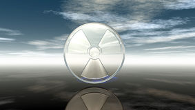 Nuclear symbol under cloudy sky Royalty Free Stock Photo