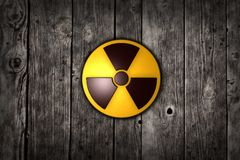 Nuclear symbol on wood Stock Photography