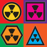 Nuclear symbols. Set of Nuclear warning symbols, traditional yellow circle, pink square, orange hexagon and blue triangle Royalty Free Stock Photos
