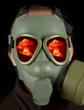 Nuclear war. Gas mask with reflections of nuclear mushroom on eye visors Royalty Free Stock Image
