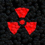 Nuclear warning. Bright red nuclear warning symbol on eroded background royalty free illustration