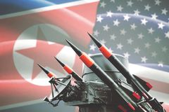 Nuclear weapon with North Korea and USA flag. Concept of conflict. Nuclear weapon of mass destruction with North Korea and USA flag in the background Royalty Free Stock Image