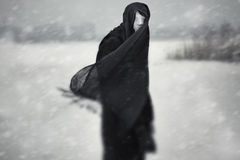 Nuclear winter. Anonymous person with bandaged head under the nuclear snowstorm Stock Photography