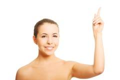 Nude γυναίκα που δείχνει επάνω Στοκ Εικόνες