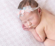 Nude baby girl speeping on her belly Stock Images