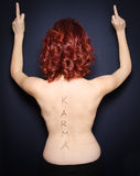 Nude back woman view with karma text. Stock Image