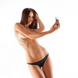 Nude beautiful woman doing selfie on white background Stock Photo