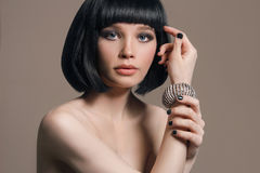 Nude beautiful woman in jewelry. Studio fashion portrait of nude beautiful woman in jewelry. Girl with bob hairstyle Royalty Free Stock Photography