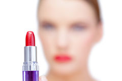 Nude blonde model holding red lipstick Stock Photo
