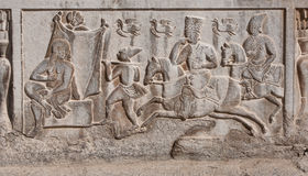 Nude bride and groom on horseback depicted on a stone slab of armenian cathedral Royalty Free Stock Photo