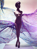 Nude elegant woman surrounded by flowing draperies Royalty Free Stock Images