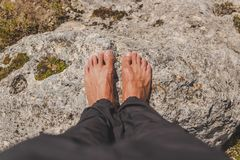 Male barefoot placed on a rock royalty free stock photos