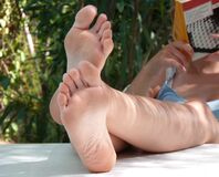 nude feet and legs on the table Stock Images