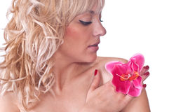 Nude female body with flower on her shoulder. Nude female body with flower orchid on her shoulder over white background Royalty Free Stock Image