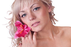 Nude female body with flower on her shoulder. Nude female body with flower orchid on her shoulder over white background Royalty Free Stock Photos