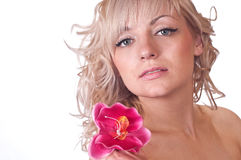 Nude female body with flower on her shoulder royalty free stock photography