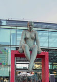 Nude Female Sculpture. Bronze nude sculpture of a Woman sitting in front of a shopping mall in Santiago, Chile Royalty Free Stock Images