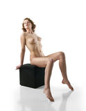Nude female sitting (front view) Stock Photo