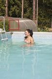 Nude girl in the pool. Naked young woman in the pool at the cottage Royalty Free Stock Photography