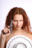 Nude girl screening with stetson and handgun Royalty Free Stock Photos
