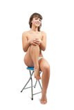 Nude girl  sitting on stool Royalty Free Stock Photo
