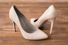 Nude high heels on wooden background Royalty Free Stock Photo