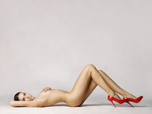 Nude lady in red shoes Royalty Free Stock Images