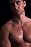 Nude man. Portrait of handsome nude man over dark background Royalty Free Stock Photos