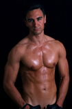 Nude man. Portrait of handsome nude man over dark background Royalty Free Stock Image