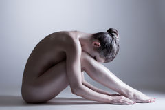 Nude model posing at camera. Concept of inner calm Royalty Free Stock Photography