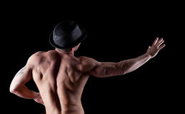 Nude muscular athletic man pose in dark Royalty Free Stock Image