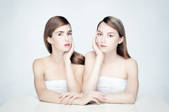 Nude portrait of two women. Studio photo of two young women in pastel colors Stock Image