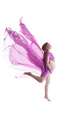 Nude pregnant woman jump with flying fabric Stock Image