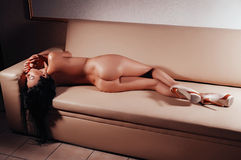Nude sexy young beautiful girl on sofa Royalty Free Stock Photo