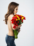 Nude young woman with flowers. royalty free stock images