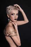 Nude short hair woman with jewelry accessories Royalty Free Stock Photos