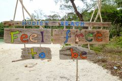 Nude sunbathing permitted sign at Koh Rong Sanloem island. On Cambodia royalty free stock images
