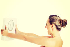 Nude topless woman holding scale. stock illustration