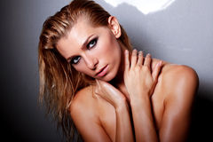 Nude Vogue. Portrait of beautiful girl with wet hair and glamour makeup Stock Images