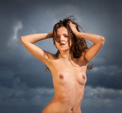 Nude woman on the beach Stock Images